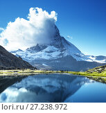 Купить «Reflection of Matterhorn in lake Riffelsee, Zermatt, Switzerland», фото № 27238972, снято 11 сентября 2017 г. (c) Iakov Kalinin / Фотобанк Лори