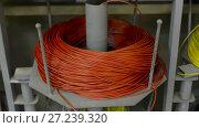Купить «Hanks of insulated wire on metal racks», видеоролик № 27239320, снято 10 ноября 2017 г. (c) Андрей Радченко / Фотобанк Лори