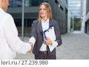 Купить «Female is talking with partner before signing contract», фото № 27239980, снято 20 августа 2017 г. (c) Яков Филимонов / Фотобанк Лори
