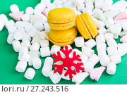 Yellow macaroons, marshmallow and red flake on green. Стоковое фото, фотограф Papoyan Irina / Фотобанк Лори