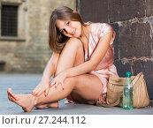Купить «young girl in romantic dress sitting in town», фото № 27244112, снято 26 августа 2017 г. (c) Яков Филимонов / Фотобанк Лори