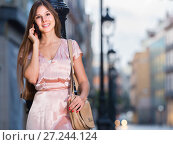 Купить «happy woman talking on phone and standing in old town», фото № 27244124, снято 26 августа 2017 г. (c) Яков Филимонов / Фотобанк Лори
