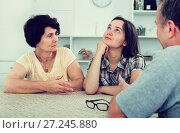 Купить «Young woman talking to mature parents», фото № 27245880, снято 16 июля 2019 г. (c) Яков Филимонов / Фотобанк Лори