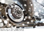 Купить «car brake disc at repair station over snow», фото № 27248572, снято 1 июля 2016 г. (c) Syda Productions / Фотобанк Лори