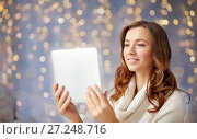 Купить «happy young woman with tablet pc at home», фото № 27248716, снято 15 октября 2016 г. (c) Syda Productions / Фотобанк Лори