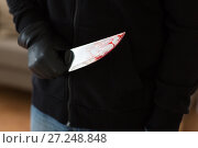Купить «close up of criminal with blood on knife», фото № 27248848, снято 5 мая 2017 г. (c) Syda Productions / Фотобанк Лори