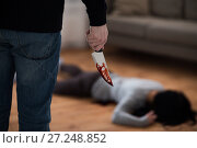 Купить «criminal with knife and dead body at crime scene», фото № 27248852, снято 5 мая 2017 г. (c) Syda Productions / Фотобанк Лори
