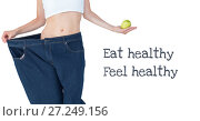 Купить «Eat healthy and Feel healthy text with fit woman in oversized jeans holding apple», фото № 27249156, снято 24 октября 2018 г. (c) Wavebreak Media / Фотобанк Лори