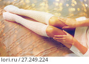 Купить «close up of woman legs in winter knee socks in bed», фото № 27249224, снято 15 октября 2016 г. (c) Syda Productions / Фотобанк Лори