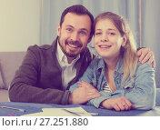 Купить «Father helping daughter with homework», фото № 27251880, снято 4 марта 2017 г. (c) Яков Филимонов / Фотобанк Лори