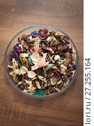 Купить «Dried flowers and herbs in glass plate - aromatherapy», фото № 27255164, снято 28 ноября 2017 г. (c) Константин Шишкин / Фотобанк Лори