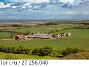 Купить «Farm near the coast, seen from Salthouse heath towards Serringham Spring, Norfolk, England, UK. April.», фото № 27256040, снято 15 декабря 2017 г. (c) Nature Picture Library / Фотобанк Лори