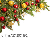 Купить «Christmas decorations, golden and red balls on the branches of a Christmas tree», фото № 27257892, снято 27 ноября 2017 г. (c) Юлия Бабкина / Фотобанк Лори