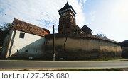 Купить «Fortified church in Valea Viilor village, Transylvania, Romania», видеоролик № 27258080, снято 7 октября 2017 г. (c) Яков Филимонов / Фотобанк Лори