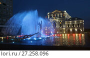 Купить «Night view of Culture Palace and colored fountain in Drobeta Turnu-Severin», видеоролик № 27258096, снято 22 октября 2017 г. (c) Яков Филимонов / Фотобанк Лори