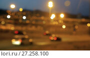 Купить «Blurred view of city highway in dusk with trace of red automobile headlight beams», видеоролик № 27258100, снято 11 августа 2017 г. (c) Яков Филимонов / Фотобанк Лори