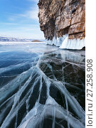 Купить «Озеро Байкал в феврале. Красивый синий лед с трещинами у прибрежных скал острова Ольхон», фото № 27258908, снято 25 февраля 2012 г. (c) Виктория Катьянова / Фотобанк Лори