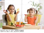 Купить «Funny little kids playing and eating in kindergarten», фото № 27259580, снято 29 ноября 2017 г. (c) Оксана Кузьмина / Фотобанк Лори