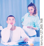 Купить «Husband and pregnant wife arguing at home», фото № 27260168, снято 18 марта 2017 г. (c) Яков Филимонов / Фотобанк Лори