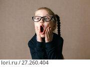 Купить «choolgirl in a shock. Educational concept.», фото № 27260404, снято 24 сентября 2017 г. (c) Иван Карпов / Фотобанк Лори