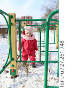 Купить «Happy little girl in warm overall plays outdoors in winter on playground», фото № 27261748, снято 29 октября 2017 г. (c) ivolodina / Фотобанк Лори