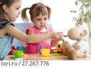 Купить «Close-up portrait of cute adorable little kids feeding caw plush toy», фото № 27267776, снято 29 ноября 2017 г. (c) Оксана Кузьмина / Фотобанк Лори