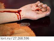 Купить «dead woman hand in blood on floor at crime scene», фото № 27268596, снято 5 мая 2017 г. (c) Syda Productions / Фотобанк Лори