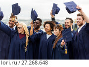 Купить «happy graduates or students waving mortar boards», фото № 27268648, снято 24 сентября 2016 г. (c) Syda Productions / Фотобанк Лори