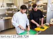 Купить «chef and cook cooking food at restaurant kitchen», фото № 27268724, снято 2 апреля 2017 г. (c) Syda Productions / Фотобанк Лори
