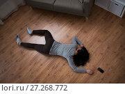 Купить «dead woman body lying on floor at crime scene», фото № 27268772, снято 5 мая 2017 г. (c) Syda Productions / Фотобанк Лори