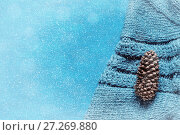 Купить «Winter background. Fir cone over gray knitted sweater with winter snowfall. Winter still life, free space for text», фото № 27269880, снято 4 ноября 2017 г. (c) Зезелина Марина / Фотобанк Лори