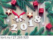 Купить «Happy New Year 2018 background with 2017 figures, Christmas toys, green fir tree branches. New Year 2018 still life», фото № 27269920, снято 29 ноября 2016 г. (c) Зезелина Марина / Фотобанк Лори