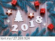 Купить «Happy New Year 2018 background with 2018 figures, Christmas toys, fir tree branches. New Year 2018 still life», фото № 27269924, снято 29 ноября 2016 г. (c) Зезелина Марина / Фотобанк Лори