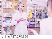 Купить «Mature female seller suggesting care products to young customer», фото № 27270836, снято 15 марта 2017 г. (c) Яков Филимонов / Фотобанк Лори