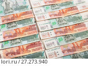 Купить «Background of five- and one-thousandth banknotes Russian rubles», фото № 27273940, снято 7 декабря 2017 г. (c) Юлия Бабкина / Фотобанк Лори