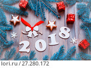 Купить «Happy New Year 2018 background with 2017 figures, Christmas toys, blue fir tree branches. New Year 2018 still life», фото № 27280172, снято 29 ноября 2016 г. (c) Зезелина Марина / Фотобанк Лори