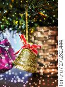 Купить «Bell on Christmas tree. Falling snow», фото № 27282444, снято 26 декабря 2015 г. (c) Евгений Ткачёв / Фотобанк Лори
