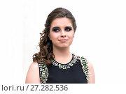 Купить «Young brunette woman in black dress. Evening make-up. Dress with jewelery», фото № 27282536, снято 26 июня 2014 г. (c) Евгений Ткачёв / Фотобанк Лори