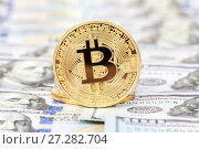 Купить «Golden bitcoin on the background of one hundred american dollars close up. Business concept of worldwide cryptocurrency», фото № 27282704, снято 11 декабря 2017 г. (c) FotograFF / Фотобанк Лори