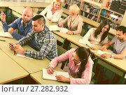 Купить «Professionals taking notes at training session», фото № 27282932, снято 17 декабря 2018 г. (c) Яков Филимонов / Фотобанк Лори
