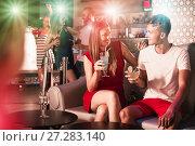 Купить «Couple talking in nightclub», фото № 27283140, снято 28 августа 2017 г. (c) Яков Филимонов / Фотобанк Лори