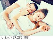 Young man and woman taking a nap together. Стоковое фото, фотограф Яков Филимонов / Фотобанк Лори