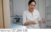 Купить «Alternative Asian Tibetan medicine, asian woman doctor prepares a glass jar», видеоролик № 27284136, снято 20 июля 2018 г. (c) Константин Шишкин / Фотобанк Лори