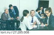 Купить «Coworkers working effectively on business project together», фото № 27285008, снято 28 октября 2016 г. (c) Яков Филимонов / Фотобанк Лори