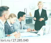 Купить «Businesswoman explaining to workgroup plans», фото № 27285040, снято 1 июля 2017 г. (c) Яков Филимонов / Фотобанк Лори