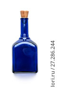 Купить «Blue glass bottle with a wooden lid on a clean white background.», фото № 27286244, снято 16 июня 2019 г. (c) Olesya Tseytlin / Фотобанк Лори