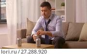 Купить «alcoholic drinking alcohol from can at home», видеоролик № 27288920, снято 10 декабря 2017 г. (c) Syda Productions / Фотобанк Лори