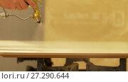 Купить «worker hand sprays urethane finish to board», видеоролик № 27290644, снято 17 ноября 2017 г. (c) Syda Productions / Фотобанк Лори