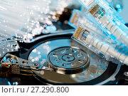 Купить «Server hard disks, illuminated optical fiber with blurred lights», фото № 27290800, снято 22 июля 2018 г. (c) Mikhail Starodubov / Фотобанк Лори