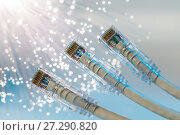 Купить «Closeup of RJ45 UTP LAN on the background of optical fibers with blurred lights», фото № 27290820, снято 19 декабря 2018 г. (c) Mikhail Starodubov / Фотобанк Лори